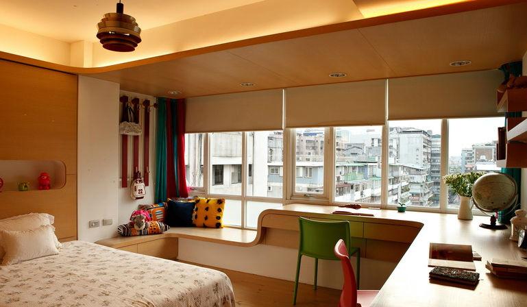 6.主卧室利用飘窗设计转角书桌和榻榻米飘窗休闲区.图片